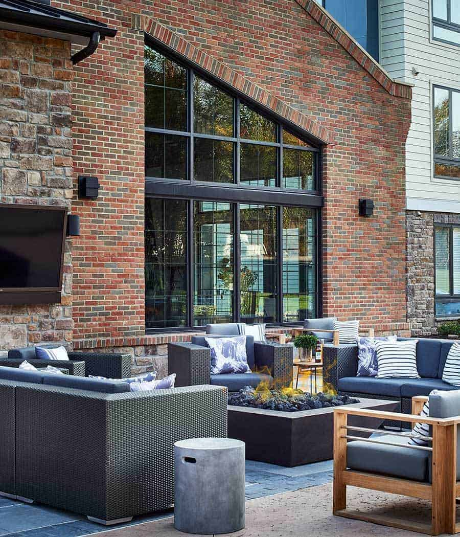 photo of outdoor lounge area with fire pit at a Toll Brothers Apartment Living property