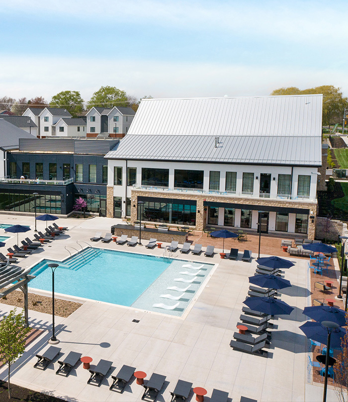 Pool, lounging area, and clubhouse at The Yards at Old State